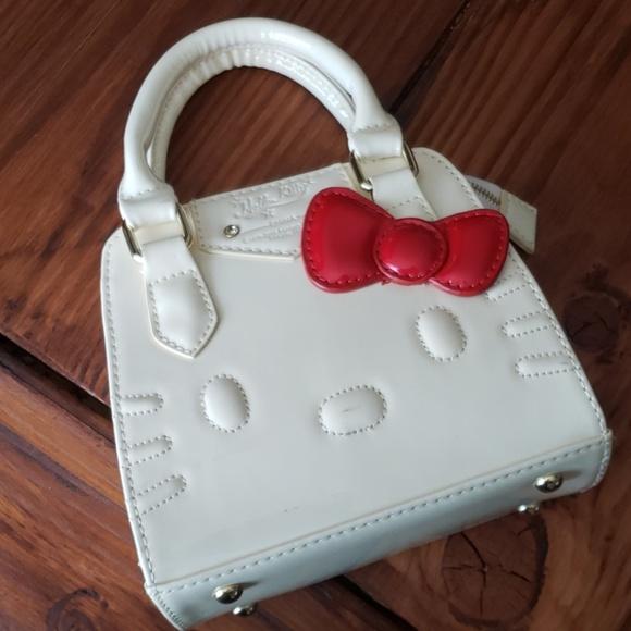 0f47dd4b9 Hello Kitty Handbags - 🚨PRICE CUT DOWN - Hello Kitty Tiny Purse🚨